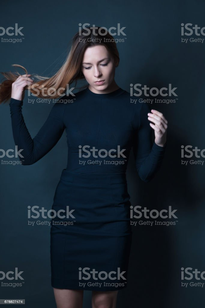 portrait of young beautiful red haired woman holding hair royalty-free stock photo