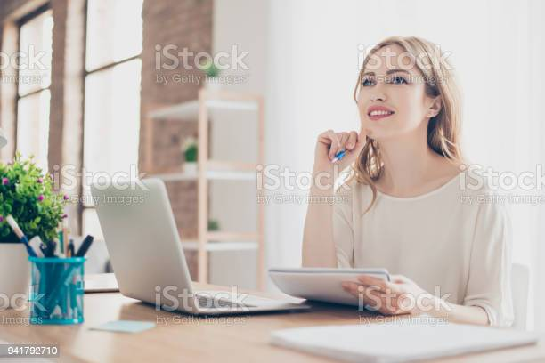 Portrait Of Young Beautiful Thoughtful Lady Sitting At The Table Working With Laptop On Writing Down New Ideas Stock Photo - Download Image Now