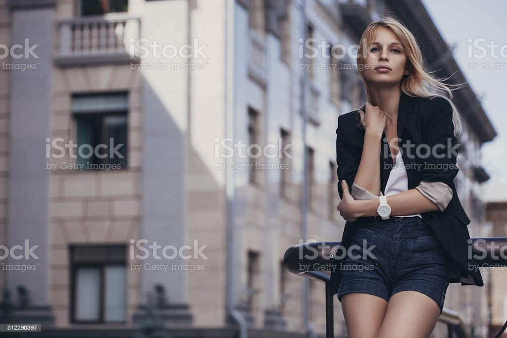 Portrait of young beautiful woman at the street stock photo