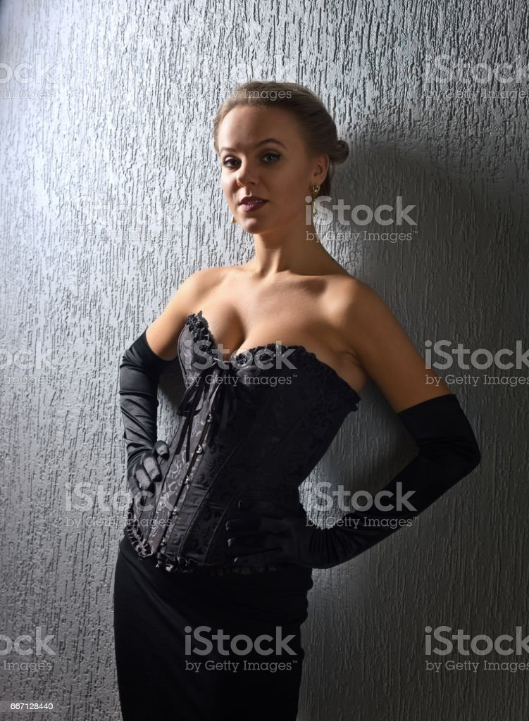 Portrait of young beautiful woman in black corset stock photo