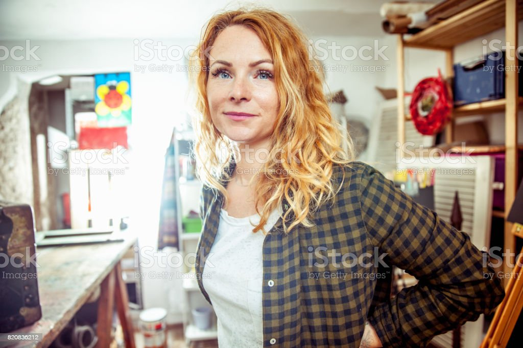 Portrait of Young Beautiful Woman in Workshop stock photo