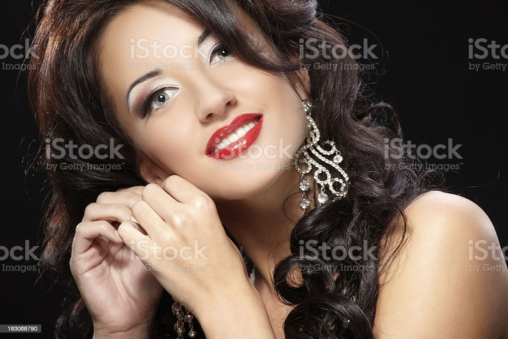 Portrait of young beautiful woman on black background royalty-free stock photo