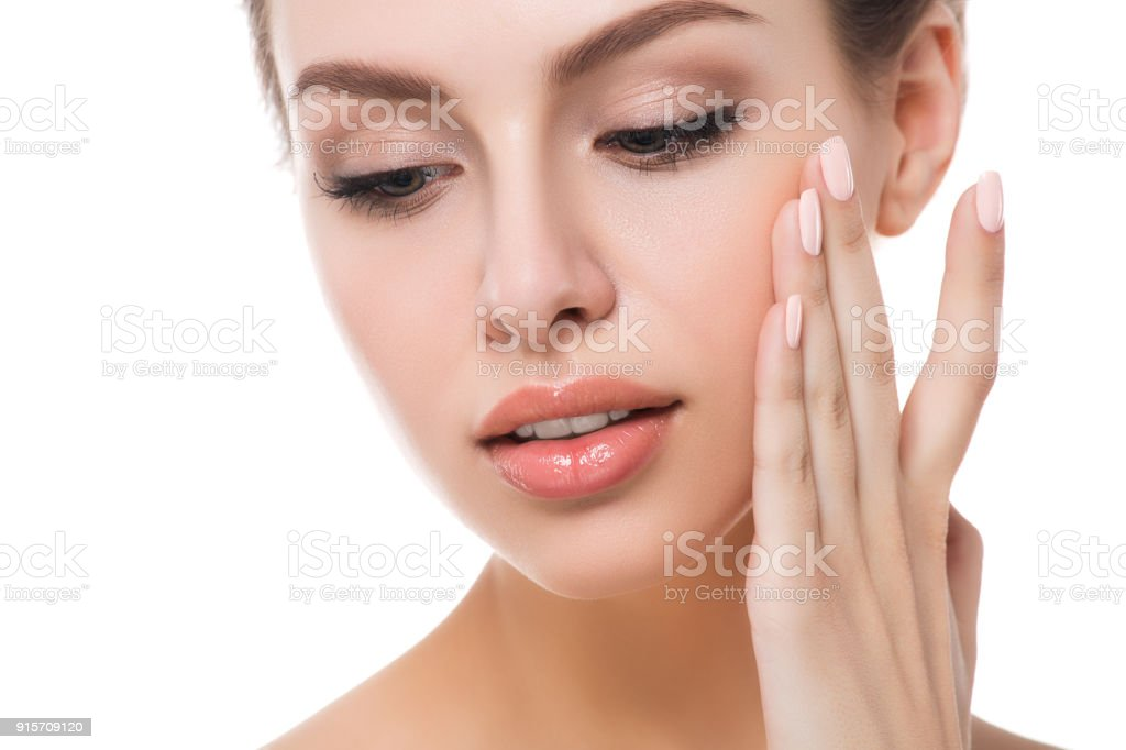 Portrait of young beautiful woman touching her face stock photo