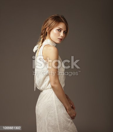 Portrait of young beautiful woman wearing lace dress