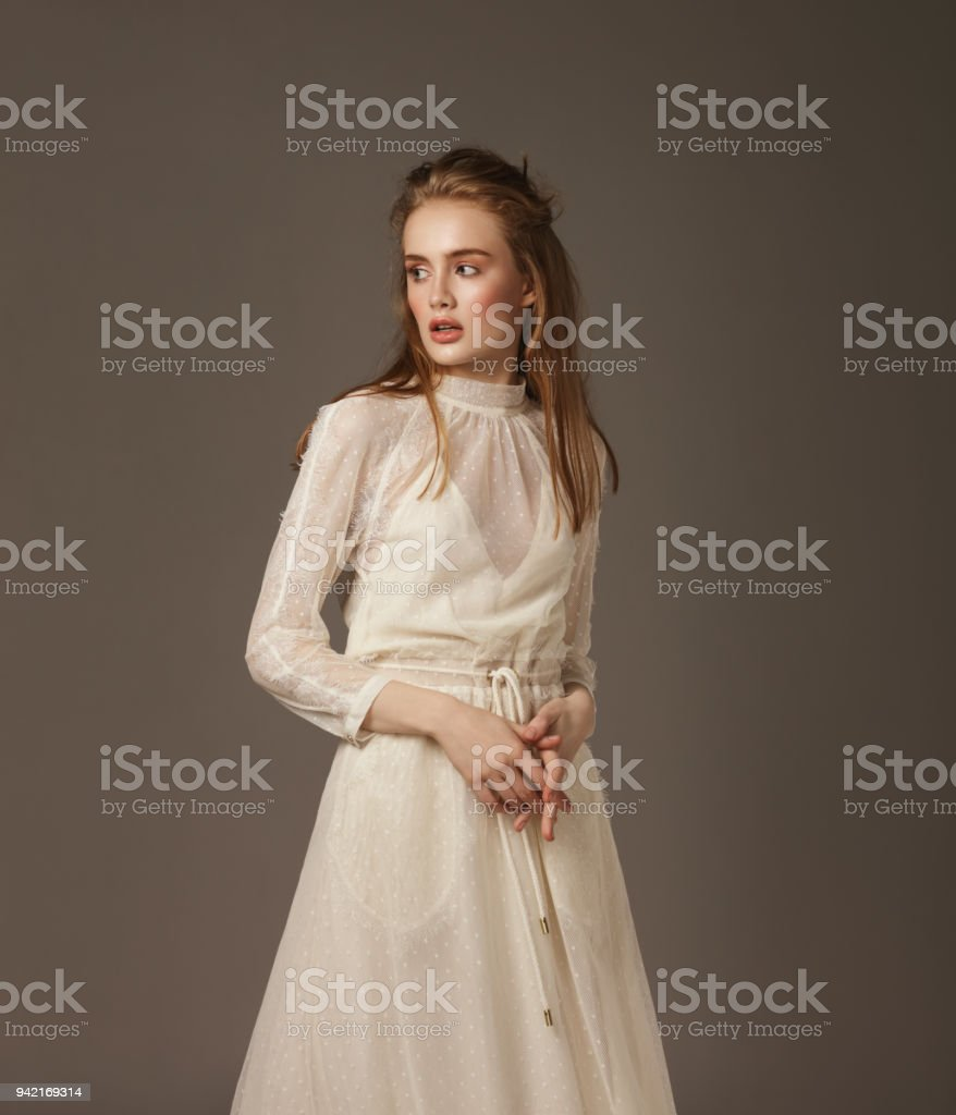 Portrait of young beautiful woman wearing lace dress stock photo