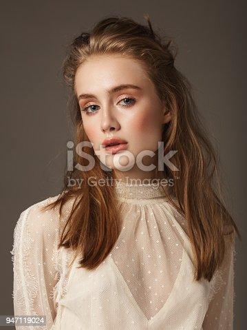 Portrait of young beautiful woman wearing lace dress