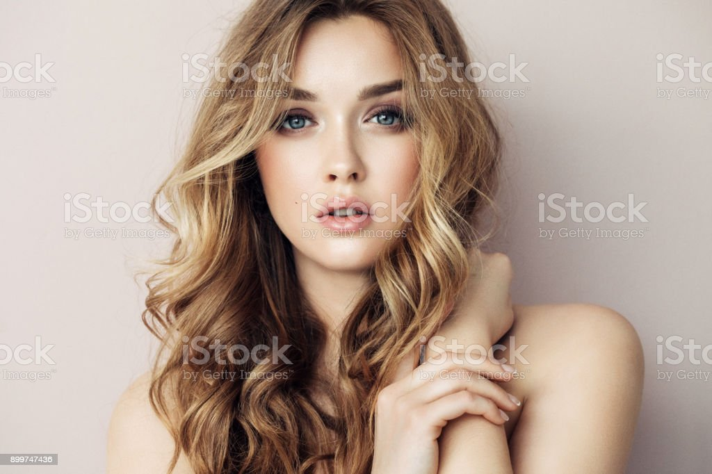 Portrait of young beautiful woman with elegant make-up and perfect hairstyle stock photo