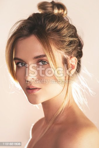 istock Portrait of young beautiful woman with perfect skin 1151651806