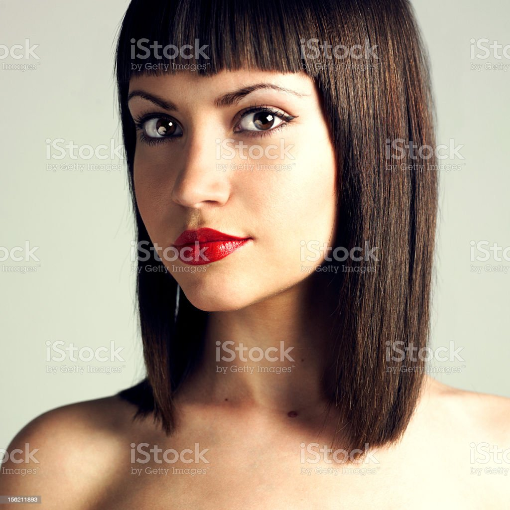 Portrait of young beautiful woman with straight hairstyle stock photo