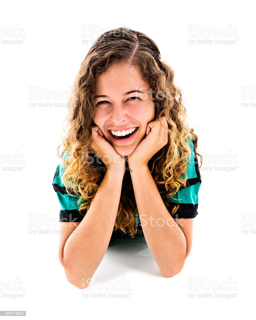 Portrait of young beauty leaning on elbows, smiling brightly stock photo