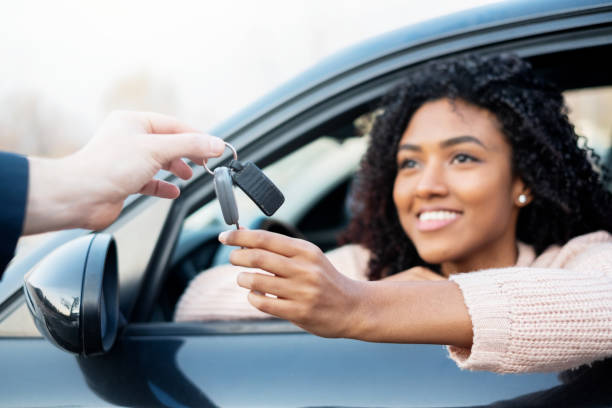 Portrait of young black woman sitting in car stock photo