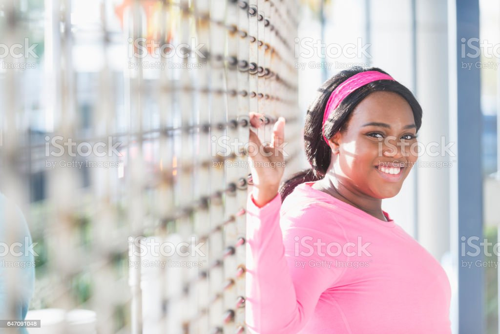 Portrait of young black woman wearing pink stock photo