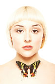 istock Portrait of young blonde with a butterfly on her neck 184998920