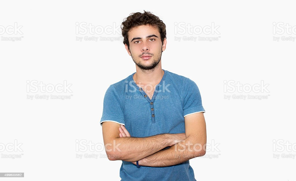Portrait of young boy against white background stock photo
