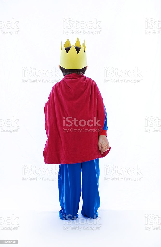 Portrait of young boy dressed as king royalty-free stock photo