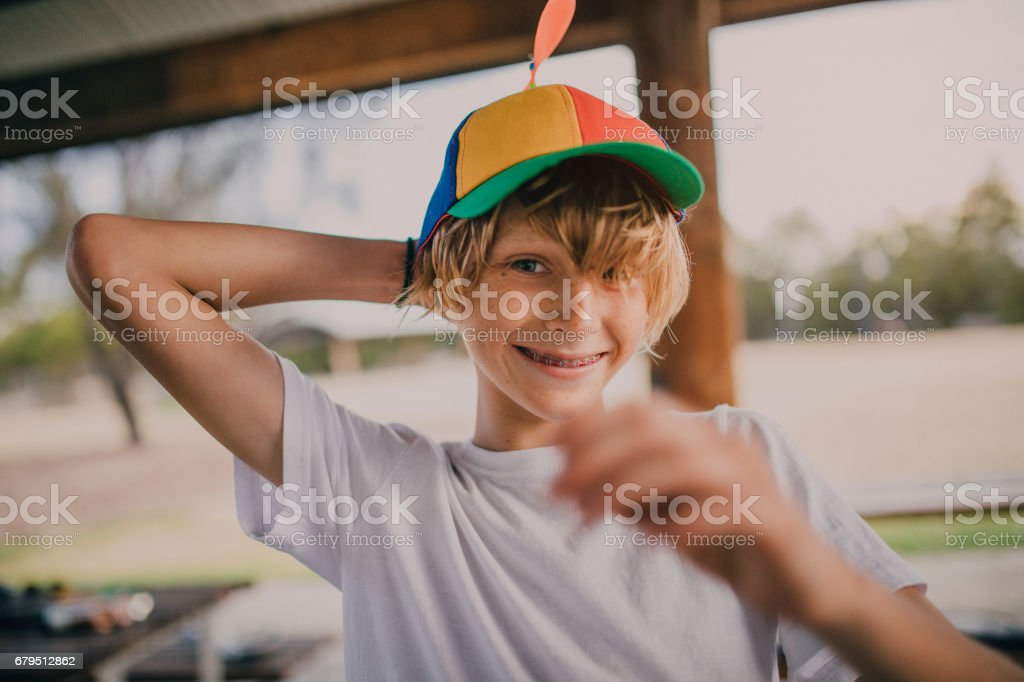 Portrait of Young Boy Wearing a Propeller Hat stock photo