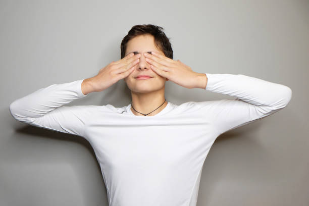 Portrait of young boy with closed eyes stock photo