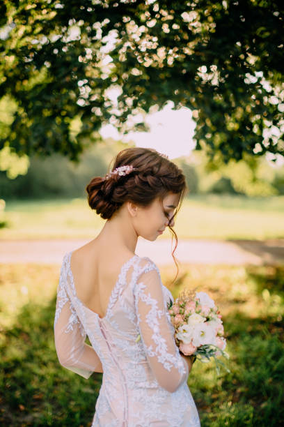 portrait of young bride against nature background stock photo