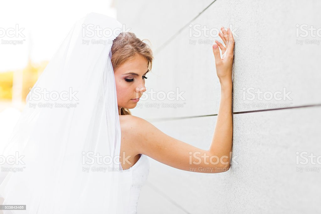 Portrait of  young bride in  white dress stock photo