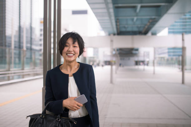 Portrait of young business woman in city stock photo