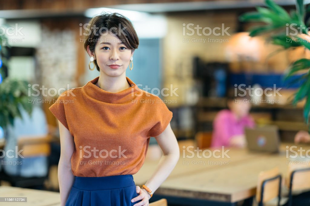 Portrait of young business woman in modenr co-working space A portrait of a young business woman in a modern co-working space. 20-29 Years Stock Photo