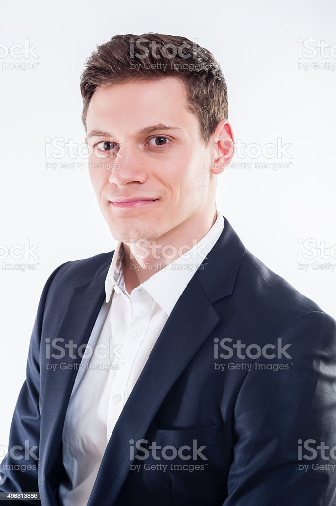 Portrait of young businessman in black suit stock photo