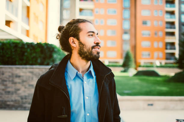 Portrait of young businessman Portrait of young businessman in the city man bun stock pictures, royalty-free photos & images