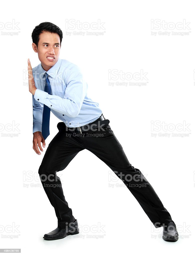 Portrait of young businessman pushing a blank board stock photo