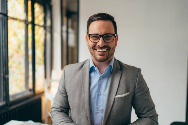 Portrait of young businessman standing in his office stock photo