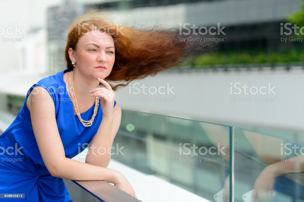 Portrait of young businesswoman against view of the city in Bangkok Thailand stock photo