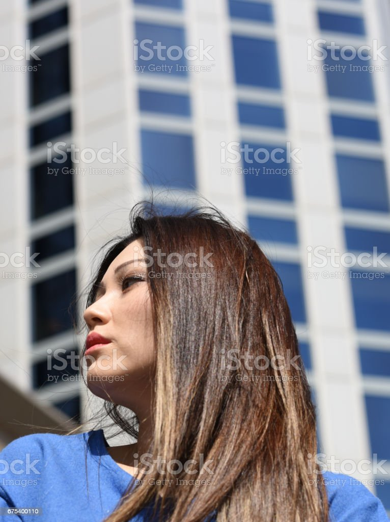 Portrait of young businesswoman in front of office building royalty-free stock photo
