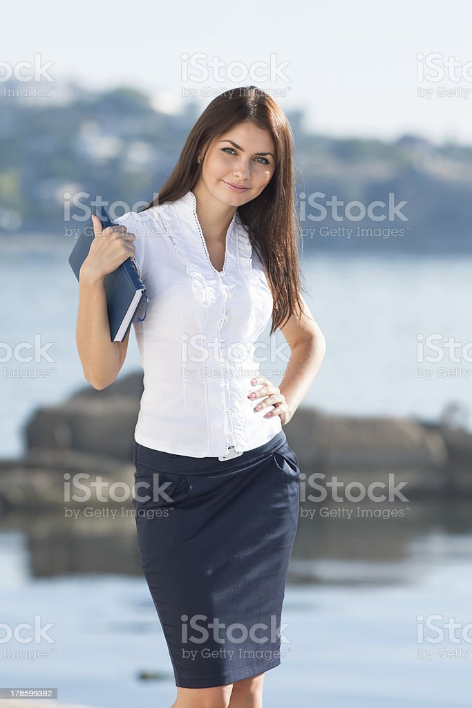 Portrait of young businesswoman outdoors stock photo