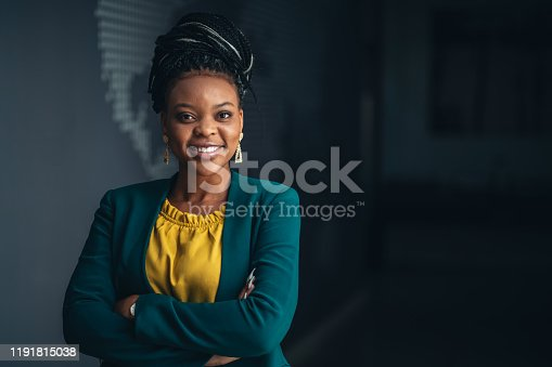 Portrait of young African businesswoman in the office looking at camera.