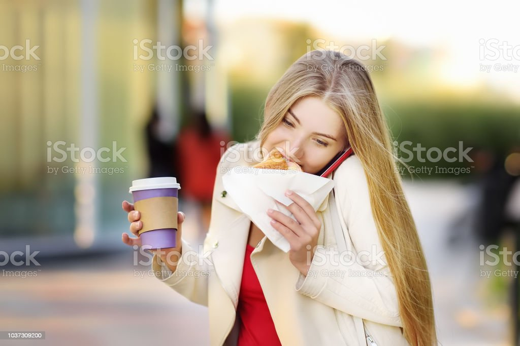 Portrait of young busy woman in the big city stock photo