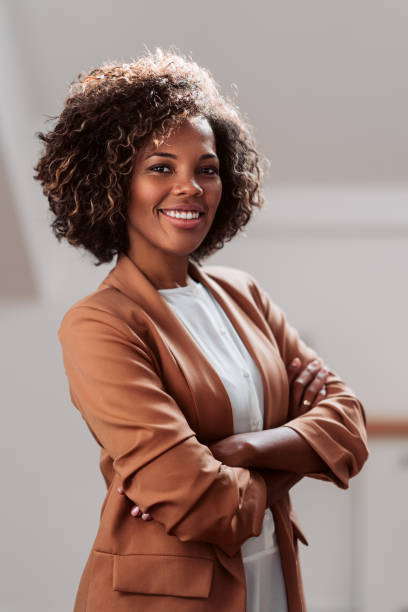 Portrait of young cheerful african american businesswoman stock photo