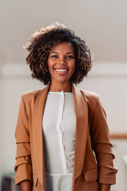 Portrait of young cheerful african american woman stock photo