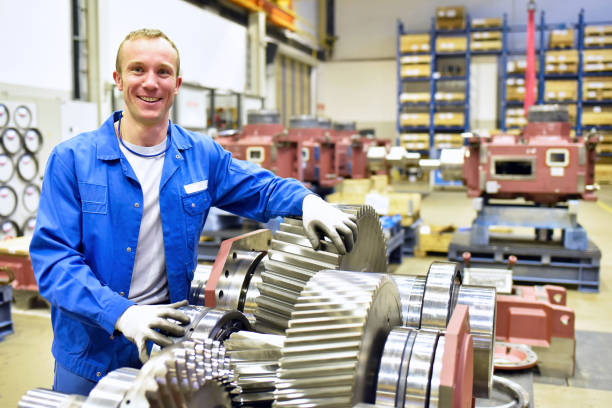 portrait of young cheerful workers in mechanical engineering stock photo