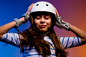Portrait of young child girl in skate helmet - safety and sports