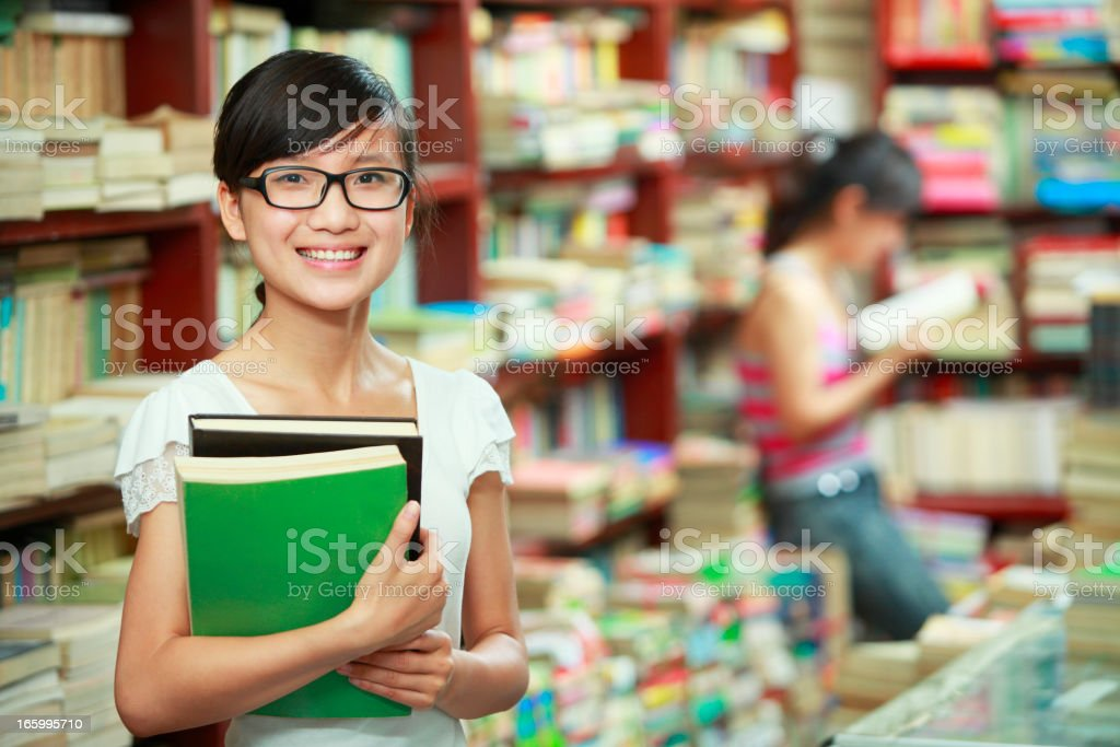 portrait of young college student in the library royalty-free stock photo