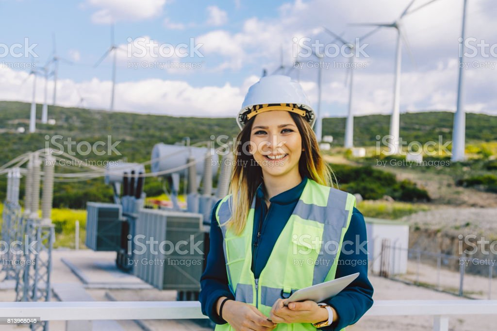 Portrait of young confident female engineer in electric power station stock photo