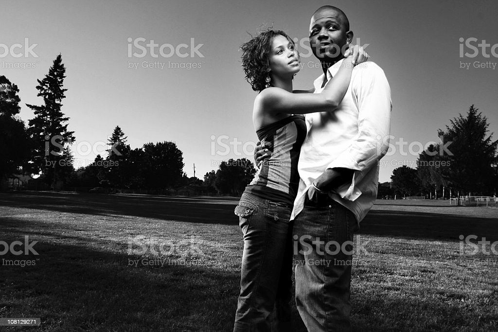 Portrait of Young Couple Embracing Outside, Black and White royalty-free stock photo