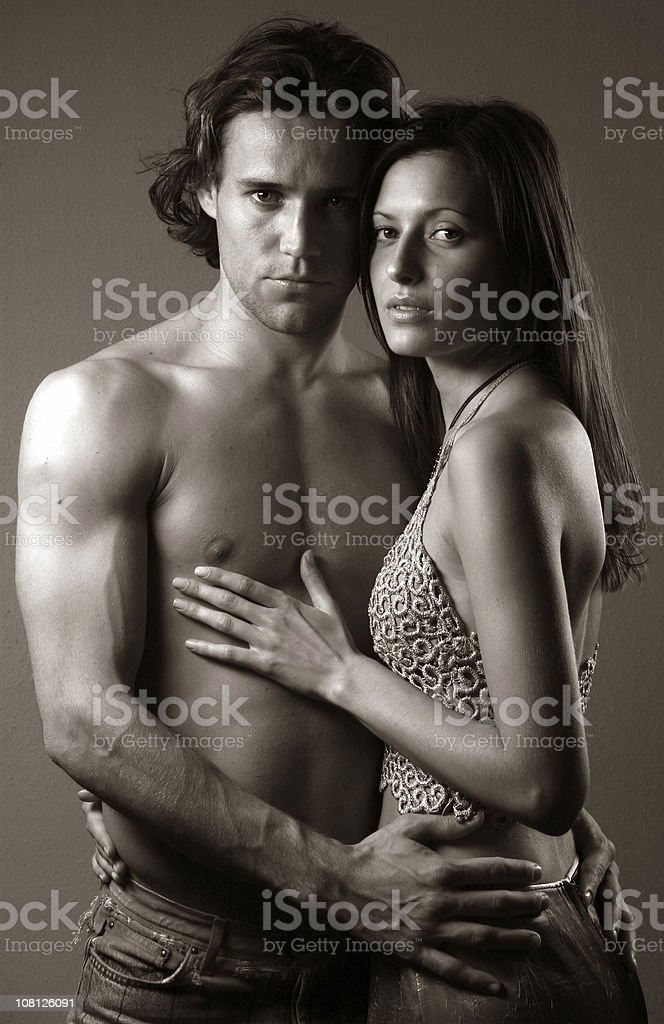 Portrait of Young Couple Hugging, Sepia Toned royalty-free stock photo
