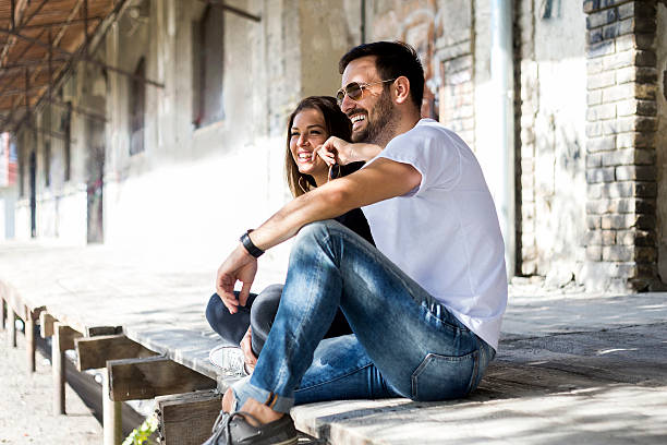 portrait of young couple - jeans stock photos and pictures