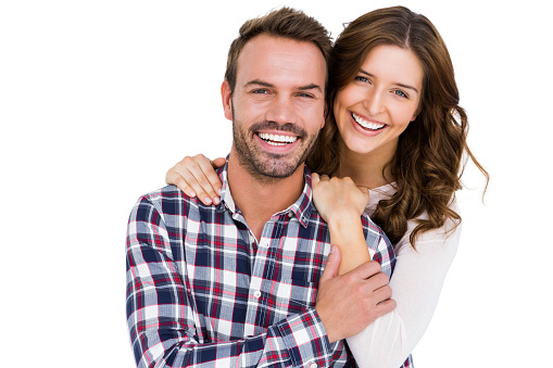 istock Portrait of young couple smiling 673176670