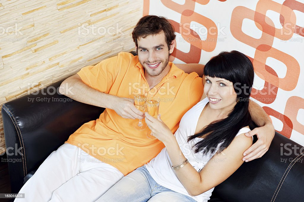 Portrait of young couple with champagne glasses stock photo
