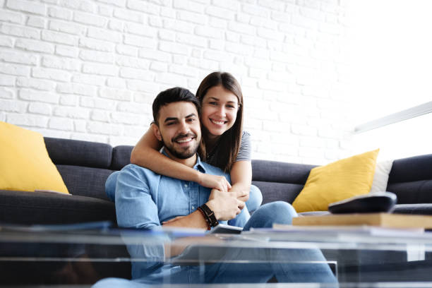 Portrait of Young Couple With Tablet PC Smiling stock photo