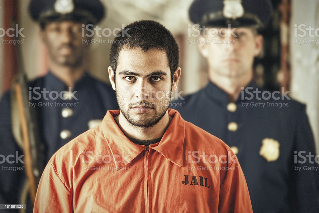 Portrait of Young Criminal in Prison stock photo