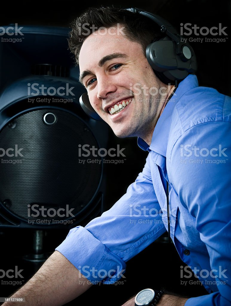 Portrait of Young DJ Man Listening Music on Headphones royalty-free stock photo