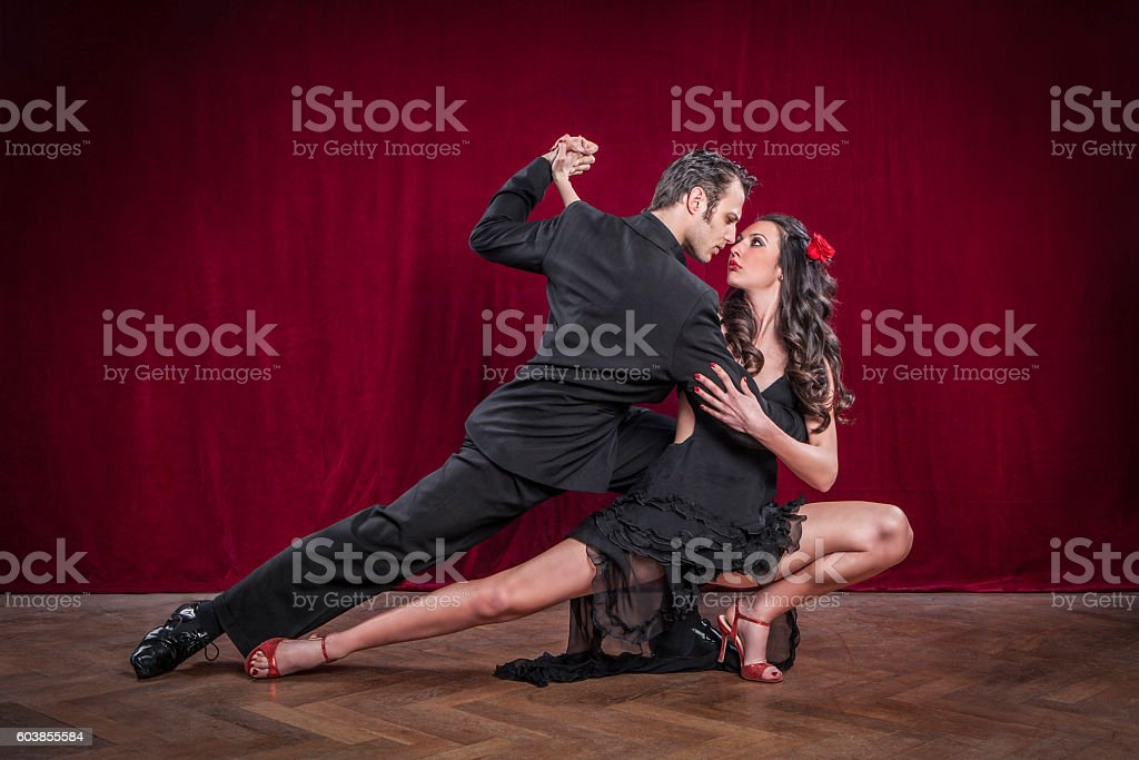 Portrait of young elegant tango dancers. stock photo