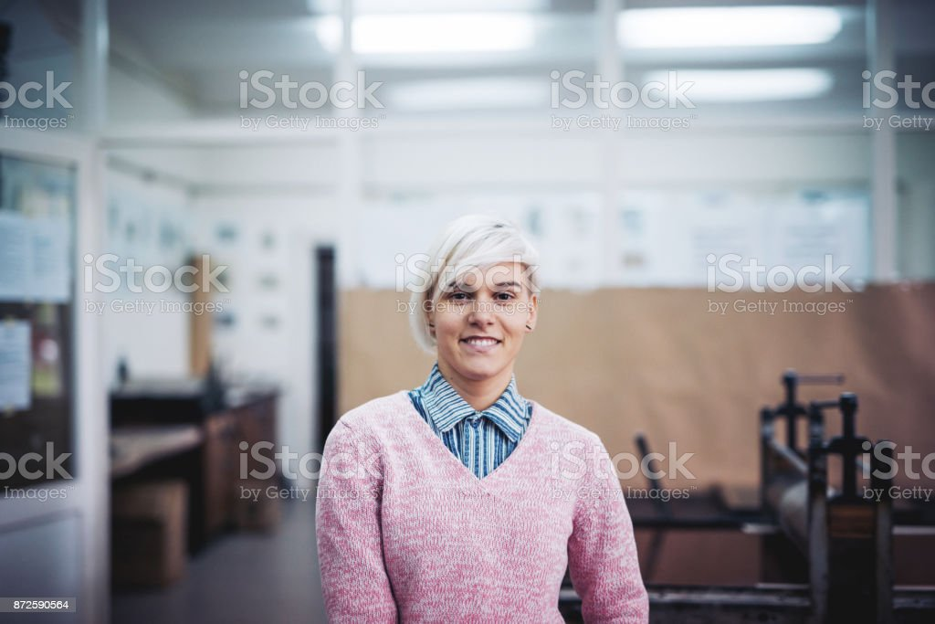 Portrait of young entrepreneur in her workshop for intaglio printing stock photo